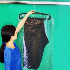 Dust-proof plastic cover for skirt or pants