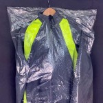 Dust-proof plastic cover for suits or dresses