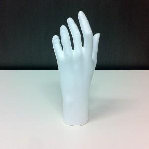 Weiblicher Hand in porexpan (Kork)