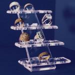 Espositore di 12 anelli in 4 basi alzate