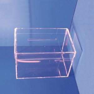 Expositor urna de votación con tapa sobre mesa