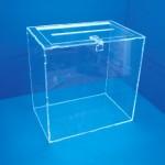Expositor urna de votació amb tapa sobre taula