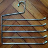 Percha de metal 5 barras 34 cm.