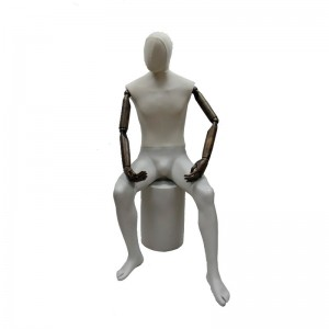Gentleman mannequin sitting without features with articulated arms